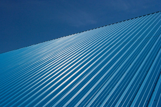 Blue metal roof on an industrial building.
