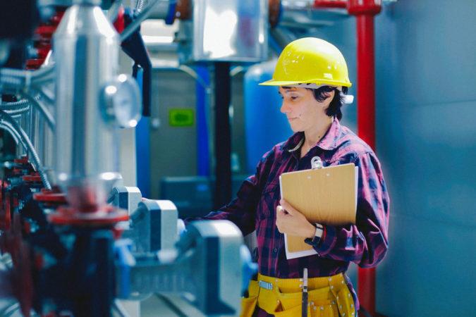 Employee take note in boiler room