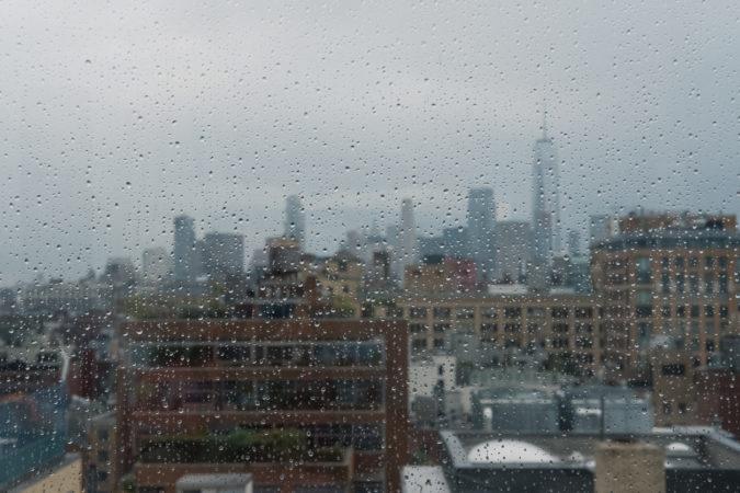 New York City view behind the rainy window