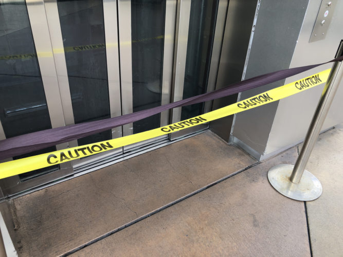 Broken elevator with caution tape