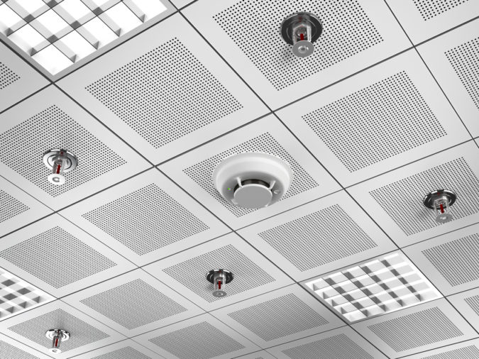 Fire detector and sprinklers mounted on the suspended ceiling.Similar images: