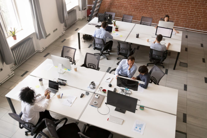 Employees working together in modern open office space