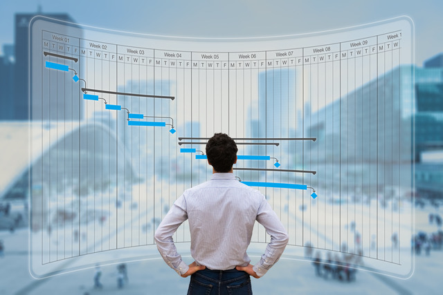 Project manager working with Gantt chart planning, tracking milestone and deliverables and updating tasks progress, scheduling skills, on virtual screen with city background (Project manager working with Gantt chart planning, tracking milestone and de