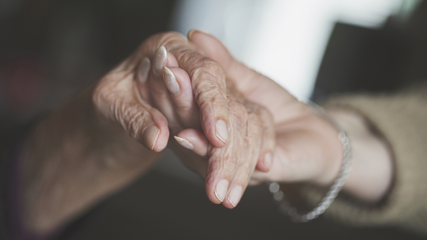 Holding hand of very old woman-home caregiver